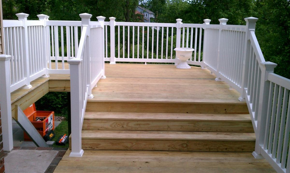 Rbm enterprises new deck with a vinyl railing for Pressure treated decking